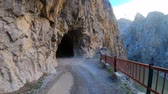 на камеру : Dark Canyon of Kemaliye with stone road and tunnels, river Euphrates running through, Erzincan, Turkey Стоковые видеозаписи