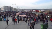 オットマン : istanbul, Turkey - March 2019: Crowd of people walking on the dockside of Eminonu square, istanbul, Turkey 動画素材