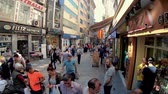 egyptisch : Istanbul, Turkey - July 2019: People shopping in Eminonu district, the old city of istanbul near spice bazaar Stockvideo