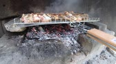 galinha : Making chicken grill barbecue over wood fire in stone fireplace during picnic Stock Footage