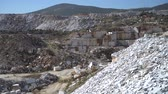 çakıl : Marble quarry pit with rocks and blocks of marble in Marmara island, Balikesir, Turkey Stok Video