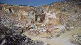 добыча : Marble quarry pit with rocks and blocks of marble in Marmara island, Balikesir, Turkey Стоковые видеозаписи