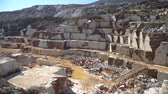 kazmak : Marble quarry pit with rocks and blocks of marble in Marmara island, Balikesir, Turkey Stok Video