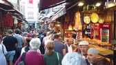 bem : Istanbul, Turkey - October 2019: The shops and crowds of people of Eminonu district, the old city of istanbul near spice bazaar