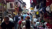 폭이 좁은 : Istanbul, Turkey - October 2019: People walking and shopping in narrow bazaar roads of Eminonu district, the old city of istanbul near spice bazaar 무비클립