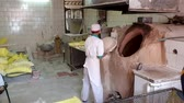 naan : Abyaneh, Iran - May 2019: Man making bread in traditional bakery shop Stock Footage