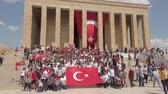 kemal : Ankara, Turkey - August 2019: Turkish people with Turkish flags infront of Anitkabir Mausoleum of Ataturk, the Great Leader Ataturk in his grave to convey his love and respect.