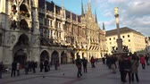 bavyera : Munich, Germany - October 2019: Tourist visiting Munich Marienplatz square most popular square in Munchen city centre old town
