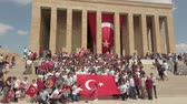 anitkabir : Ankara, Turkey - August 2019: Turkish people with Turkish flags infront of Anitkabir Mausoleum of Ataturk, the Great Leader Ataturk in his grave to convey his love and respect.