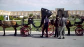 Isfahan, Iran - May 2019: Horse carriages waiting for tourists and Iranian people to have a ride around Isfahan Naqsh-e Jahan Square also called Imam Square Wideo