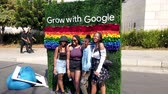 Johannesburg, South Africa - October 2019: South African girls at Google photo booth with rainbow colored flowers in South Africa gay pride