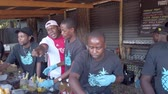 Johannesburg, South Africa - October 2019: Group of man preparing and selling local cocktail drink in their stalls in Fourways Farmers Market Wideo