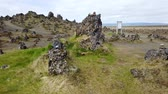 равновесие : Good luck cairns made of stones on a lava field called Laufskalavarda in southern Iceland