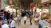 Isfahan, Iran - May 2019: Grand bazaar of Isfahan, also known as Bazar Bozorg with tourists and local people shopping, historical market