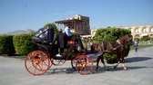 Isfahan, Iran - May 2019: Tourists having a horse carriage ride around Isfahan Naqsh-e Jahan Square also called Imam Square Wideo