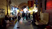 halı : Isfahan, Iran - May 2019: Grand bazaar of Isfahan, also known as Bazar Bozorg with tourists and local people shopping, historical market