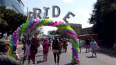 Johannesburg, South Africa - October 2019: Group of people taking selfies and photographs under the pride arch at Gay pride March