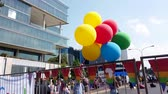 çeşitlilik : Johannesburg, South Africa - October 2019: Colorful balloons in South Africa gay pride march Stok Video