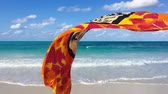 On the empty beach with silk scarf Stock Footage