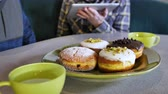 doughnut : Electronics Technology Concept Men Viewing Discussing Media on Tablet Computer Screen During Casual Meeting WIth Paczki Cream Jelly Filled Donut Pastry Plate Hot Tea Cups