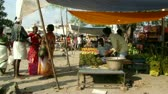 Vegetable market in Hyderabad. People buy vegetables and fruit in a small local market in India