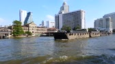 chao phraya : The cargo transports to Thailand via the Chao Phraya River, Travel by boat in Bangkok, River life of the capital, Sky view with beautiful river, Travel around the world, Relax by boat departure. Stock Footage