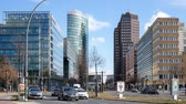 turyści : BERLIN, GERMANY - FEBRUARY 24, 2018: Traffic Near Potsdamer Platz In Berlin, Germany, Skyscrapers In The Background