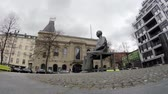 literatura : BERLIN, GERMANY - MARCH 27, 2018: Time Lapse: Statue of Bertolt Brecht In Front of The Theatre of Famous Berliner Ensemble