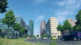 шины : BERLIN, GERMANY - MAY 19, 2018: Fish-Eye Time Lapse: Traffic Near Potsdamer Platz In Berlin, Germany, Skyscrapers In The Background, Zoom Out Стоковые видеозаписи