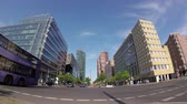 небоскребы : BERLIN, GERMANY - MAY 19, 2018: Fish-Eye: Traffic Near Potsdamer Platz In Berlin, Germany, Skyscrapers In The Background