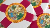 hrdý : US State Buttons: Pile of Florida Flag Badges, Focus And Zoom Out