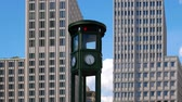 almanca : Pan Shot: The Clock At Famous Potsdamer Platz In Berlin, Germany