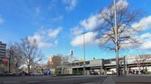 шины : BERLIN, GERMANY - FEBRUARY 4, 2018: Time Lapse: Traffic And Clouds At Metro Station Nollendorfplatz In Berlin, Germany In Winter