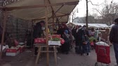 çarşı : BERLIN, GERMANY - FEBRUARY 6, 2019: Merchants And Buyers At A Turkish Food Market Square In Berlin, Germany Stok Video