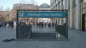 německo : BERLIN, GERMANY - FEBRUARY 16, 2019: Tourists At Entrance To Metro Station Zoologischer Garten In Berlin, Germany