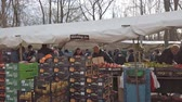 islam : BERLIN, GERMANY - FEBRUARY 23, 2019: Merchants And Buyers At A Turkish Food Market Square In Berlin, Germany Stok Video