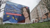 anuncios : BERLIN, GERMANY - APRIL 13, 2019: Timelapse: Campaign Poster of Katarina Barley, German Lead Candidate For The SPD For The Elections To The European Parliament In Berlin, Germany
