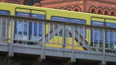 BERLIN, GERMANY - JUNE 24, 2019: Yellow BVG U-Bahn Metro Train In Front of Luther Church In Berlin, Germany