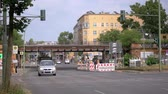 BERLIN, GERMANY - JULY 14, 2019: Timelapse: Traffic And Yellow BVG Bus At The Yorckbruecken, Historic Railway Bridges Spanning Over Yorckstrasse In Berlin, Germany Stock mozgókép