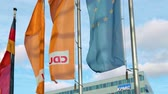 曇った : BERLIN, GERMANY - OCTOBER 4, 2019: EU, Germany And CDU Flags In Front of Konrad-Adenauer-Haus In Berlin, Germany