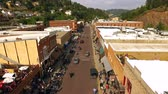 main street : Aerial View Deadwood South Dakota Downtown Motorcycle Rally Stock Footage