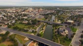 テキサス州 : Aerial View Moving over The River in Downtown San Angelo West Texas 動画素材