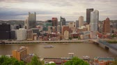 pittsburgh : Pittsburgh Pennsylvania Downtown Urban City Skyline Boats Moving Monongahela River Stock Footage
