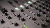 mix : Mixing console also called audio mixer, sound board, mixing deck or mixer is an electronic device Stock Footage