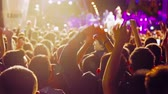 group : crowd of people dancing at the concert singer on stage Stock Footage
