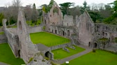 catolicismo : Aerial view to ruins of Dryburgh Abbey on the banks of the River Tweed in the Scottish Borders, was nominally founded on 10 November 1150, Scotland. Vídeos