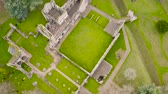 adorar : Aerial view to ruins of Dryburgh Abbey on the banks of the River Tweed in the Scottish Borders, was nominally founded on 10 November 1150, Scotland. Stock Footage