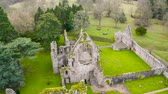 Aerial view to ruins of Dryburgh Abbey on the banks of the River Tweed in the Scottish Borders, was nominally founded on 10 November 1150, Scotland. Dostupné videozáznamy