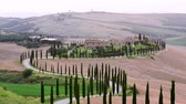 fazenda : Tuscany twilight rural landscape with house, cypress road and hills