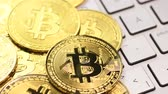 e commerce : Bitcoin cryptocurrency. Golden coins on laptop keyboard, macro shot with panning. Stock Footage